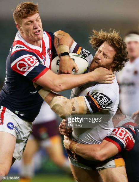 Korbin Sims of the Broncos is tackled by Dylan Napa of the Roosters during the round 13 NRL match between the Sydney Roosters and the Brisbane...