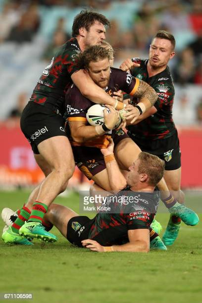 Korbin Sims of the Broncos is tackled during the round eight NRL match between the South Sydney Rabbitohs and the Brisbane Broncos at ANZ Stadium on...