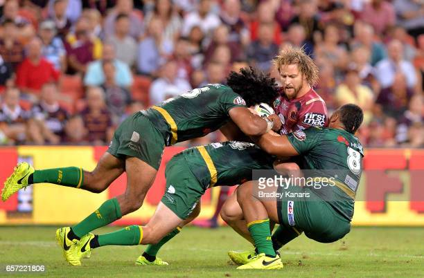 Korbin Sims of the Broncos is tackled during the round four NRL match between the Brisbane Broncos and the Canberra Raiders at Suncorp Stadium on...
