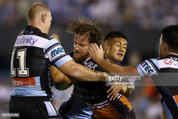 Korbin Sims of the Broncos is tackled during the round one NRL match between the Cronulla Sharks and the Brisbane Broncos at Southern Cross Group...