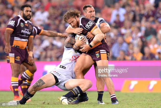 Korbin Sims of the Broncos is tackled during the round two NRL match between the Brisbane Broncos and the North Queensland Cowboys at Suncorp Stadium...