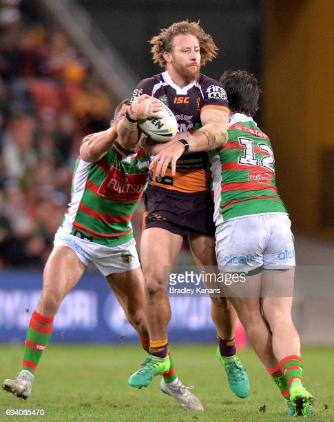 Korbin Sims of the Broncos takes on the defence during the round 14 NRL match between the Brisbane Broncos and the South Sydney Rabbitohs at Suncorp...