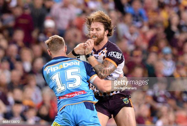Korbin Sims of the Broncos takes on the defence during the round seven NRL match between the Brisbane Broncos and the Gold Coast Titans at Suncorp...