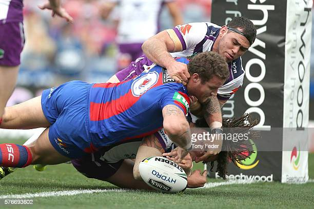 Korbin Sims of the Knights drops the ball as he attempts to score a try during the round 19 NRL match between the Newcastle Knights and the Melbourne...