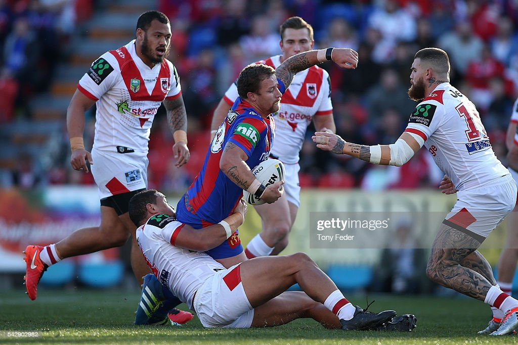 Korbin Sims of the Knights is tackled by the Dragons defence during the round 16 NRL match between the Newcastle Knights and the St George Illawarra Dragons at Hunter Stadium on June 25, 2016 in Newcastle, Australia.