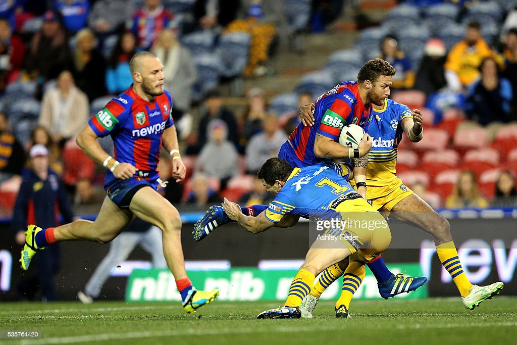 Korbin Sims of the Knights is tackled by the Eels defence during the round 12 NRL match between the Newcastle Knights and the Parramatta Eels at Hunter Stadium on May 30, 2016 in Newcastle, Australia.