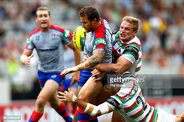 Korbin Sims of the Knights is tackled during the match between the Knights and the Rabbitohs in the 2015 Auckland Nines at Eden Park on February 1...