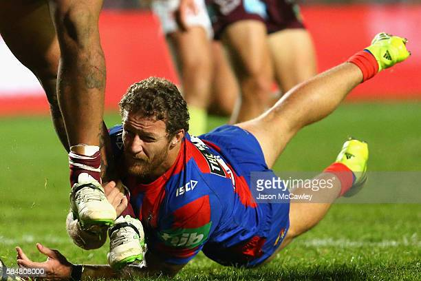 Korbin Sims of the Knights tackles during the round 21 NRL match between the Manly Sea Eagles and the Newcastle Knights at Brookvale Oval on July 31...