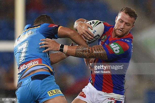 Korbin Sims of the Knights takes on the defence during the round one NRL match between the Gold Coast Titans and the Newcastle Knights at Cbus Super...