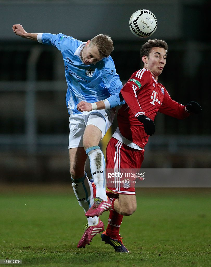 Korbinian Burger (L) of 1860 Muenchen battles for the ball with Michael Eberwein of FC Bayern during the A Juniors Bundesliga match between 1860 Muenchen and Bayern Muenchen at Stadion an der Gruenwalder Strasse on February 21, 2014 in Munich, Germany.