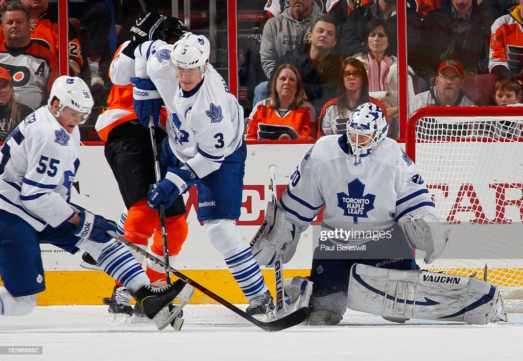 Korbinian Holzer #55, <a gi-track='captionPersonalityLinkClicked' href=/galleries/search?phrase=Dion+Phaneuf&family=editorial&specificpeople=545455 ng-click='$event.stopPropagation()'>Dion Phaneuf</a> #3 and goalie <a gi-track='captionPersonalityLinkClicked' href=/galleries/search?phrase=Ben+Scrivens&family=editorial&specificpeople=7185205 ng-click='$event.stopPropagation()'>Ben Scrivens</a> #30 of the Toronto Maple Leafs combine to stop a shot brom the Philadelphia Flyers in the third period of an NHL Hockey game at Wells Fargo Center on February 25, 2013 in Philadelphia, Pennsylvania.