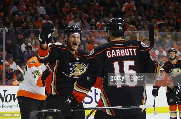 Korbinian Holzer of the Anaheim Ducks congratulates Ryan Garbutt on his game winning goal at 1134 of the third period against the Anaheim Ducks at...