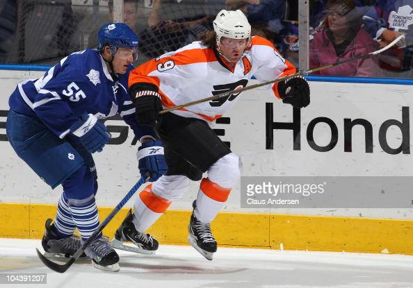 Korbinian Holzer of the Toronto Maple Leafs tries to hold up Scott Hartnell of the Philadelphia Flyers in a preseason game on September 232010 at the...