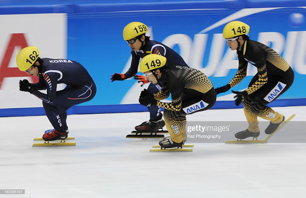 Korea and Japan battle in Heat 4 of Men 5000m Relay during day one of the ISU World Cup Short Track at Nippon Gaishi Arena on November 30, 2012 in Nagoya, Japan.