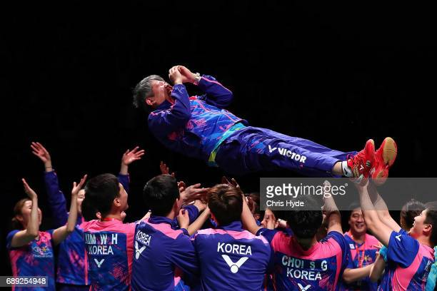 Korea coach Kang Kyung Jin is thrown in the air after winning the Final match against China during the Sudirman Cup at the Carrara Sports Leisure...