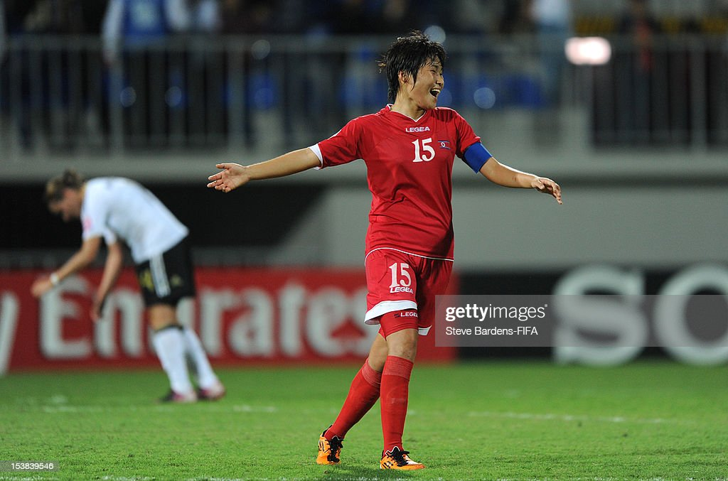 Korea DPR Captain Chung Bok Choe celebrates victory at the final whistle of the FIFA U-17 Women's World Cup 2012 Semi-Final match between Korea DPR and Germany at 8KM Stadium on October 9, 2012 in Baku, Azerbaijan.
