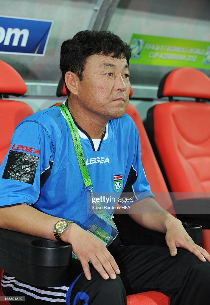 Korea DPR coach Yong Bong Hwang looks on before the start of the FIFA U-17 Women's World Cup 2012 Semi-Final match between Korea DPR and Germany at 8KM Stadium on October 9, 2012 in Baku, Azerbaijan.