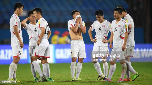 Korea DPR players can't hide their disappointment at the end of the FIFA U17 World Cup India 2017 group D match between Spain and Korea DPR at the...