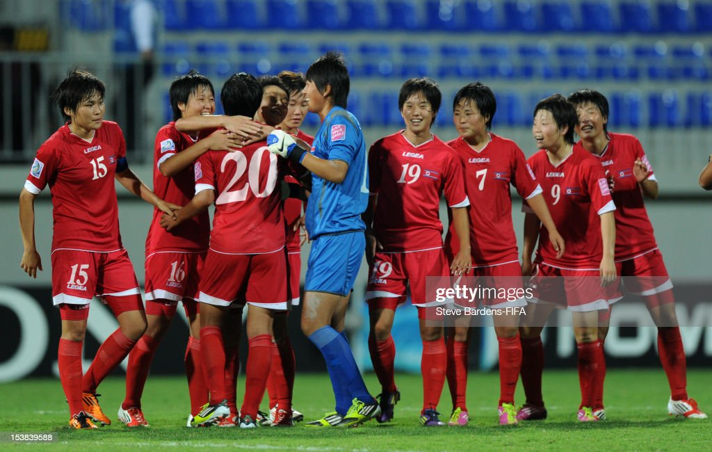 Korea DPR players celebrate victory at the final whistle of the FIFA U-17 Women's World Cup 2012 Semi-Final match between Korea DPR and Germany at 8KM Stadium on October 9, 2012 in Baku, Azerbaijan.