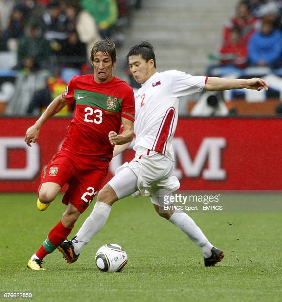 Korea DPR's JongHyok Cha and Portugal's Alexandre Fabio Coentrao battle for the ball