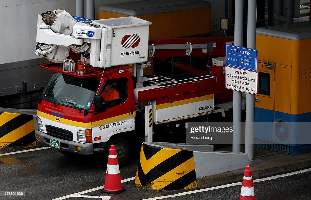 A Korea Electric Power Corp. (Kepco) truck passes through a gate at the Customs, Immigration and Quarantine (CIQ) office as they travel toward the Gaeseong Industrial Complex, on a road linked to North Korea, near the demilitarized zone (DMZ) in Paju, South Korea, on Friday, July 12, 2013. North Korea notified South Korea today that it has deferred two separate sets of talks on the tours and the family reunions it proposed yesterday, and said it wants to focus on the ongoing dialog to reopen the joint Gaeseong industrial zone, the Souths Unification Ministry said in an e-mailed statement. The two sides yesterday decided to hold talks in Gaeseong on July 15, which will be their third round in one week, on normalizing operations in Gaeseong after the North unilaterally recalled its workers in April. Photographer: SeongJoon Cho/Bloomberg via Getty Images