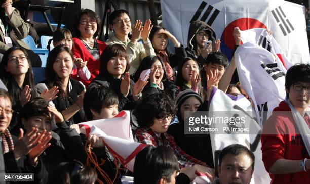 Korea fans show their support during their International Hockey Federation Olympic qualifing match at Belfield in Dublin