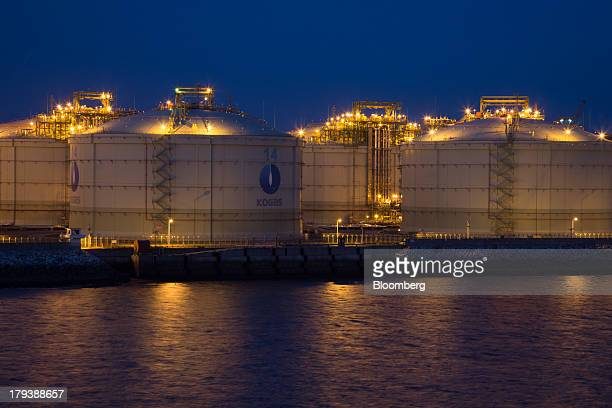 Korea Gas Corp liquefied natural gas tanks stand at night at the company's LNG terminal in Pyeongtaek South Korea on Monday Sept 2 2013 South Korea...