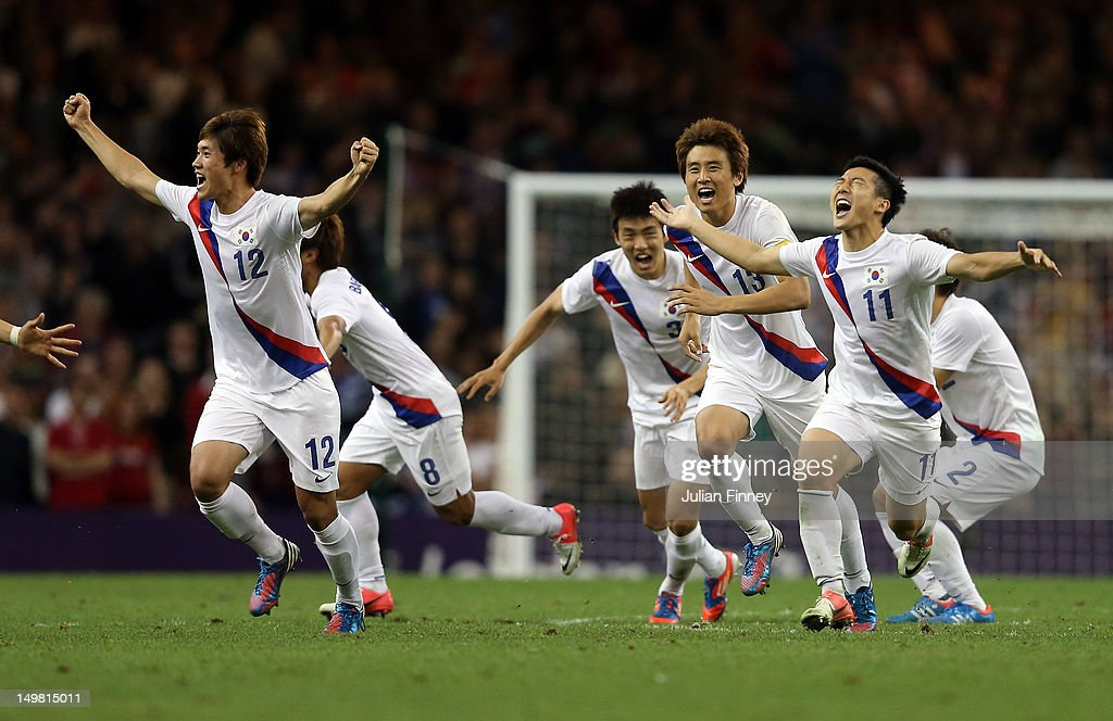 Korea players celebrate winning the penalty shoot out during the Men's Football Quarter Final match between Great Britain and Korea, on Day 8 of the London 2012 Olympic Games at Millennium Stadium on August 4, 2012 in Cardiff, Wales.