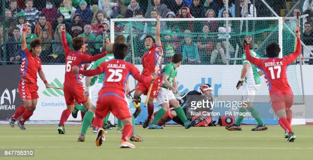 Korea react after they beat Ireland 32 during their International Hockey Federation Olympic qualifing match at Belfield in Dublin