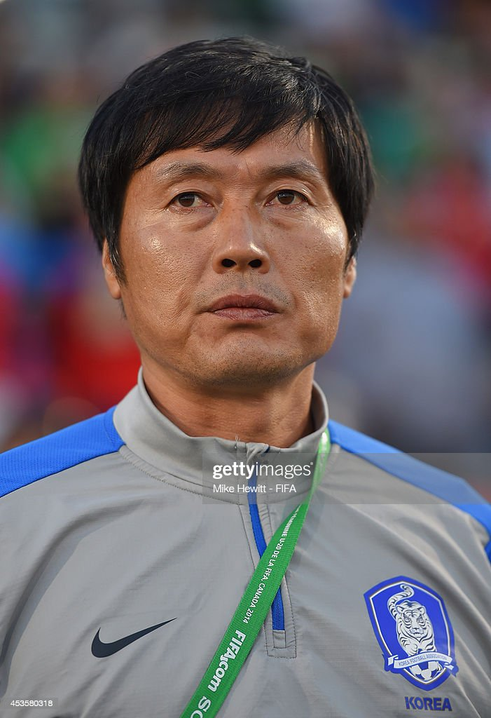 Korea Republic coach Jong Songchon look on during the FIFA U-20 Women's World Cup Canada 2014 Group D match between Korea Republic and Mexico at the National Soccer Stadium on August 13, 2014 in Toronto, Canada.