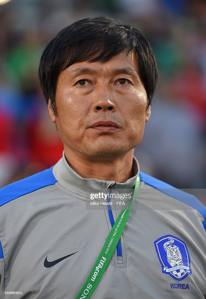 Korea Republic coach Jong Songchon looks on during the FIFA U-20 Women's World Cup Canada 2014 Group D match between Korea Republic and Mexico at the National Soccer Stadium on August 13, 2014 in Toronto, Canada.