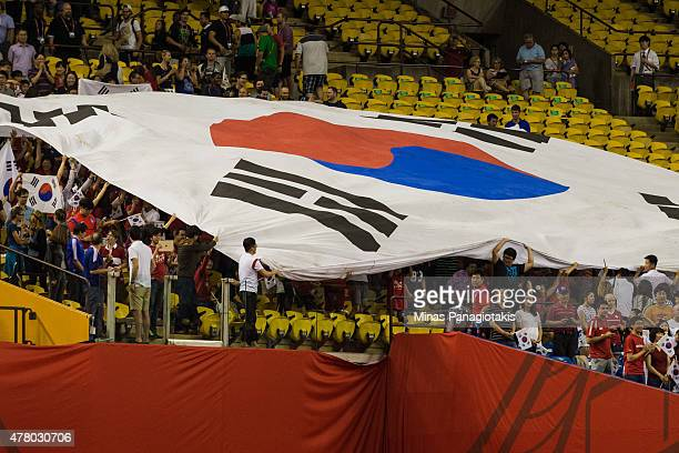 Korea Republic fans bring out a giant flag during the 2015 FIFA Women's World Cup Round of 16 match against France at Olympic Stadium on June 21 2015...