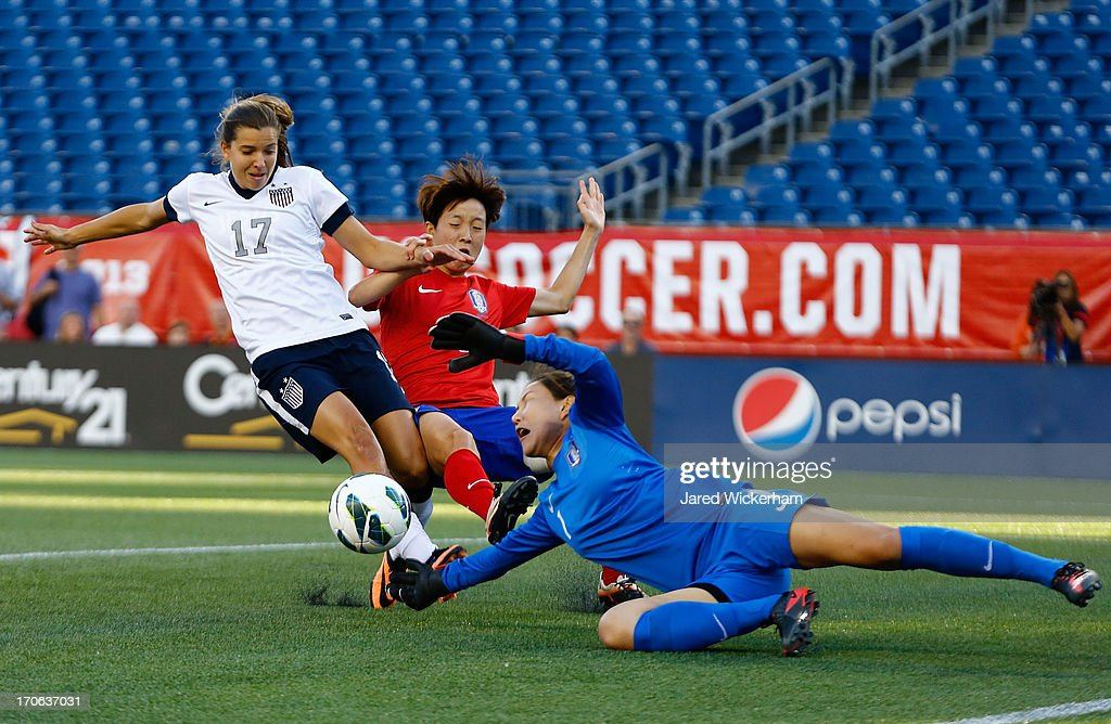 Korea Republic goalkeeper Kim Jungmi #1 makes a save in front of US Womens National midfielder <a gi-track='captionPersonalityLinkClicked' href=/galleries/search?phrase=Tobin+Heath&family=editorial&specificpeople=861695 ng-click='$event.stopPropagation()'>Tobin Heath</a> #17 in the first half during the game at Gillette Stadium on June 15, 2013 in Foxboro, Massachusetts.