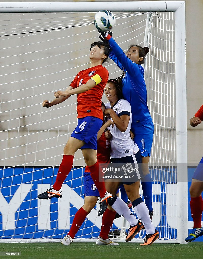 Korea Republic goalkeeper Kim Jungmi #1 makes a save over US Womens National forward <a gi-track='captionPersonalityLinkClicked' href=/galleries/search?phrase=Alex+Morgan+-+Soccer+Player&family=editorial&specificpeople=1057310 ng-click='$event.stopPropagation()'>Alex Morgan</a> #13 and Korea Republic defender Shim Seoyeon #4 during the game at Gillette Stadium on June 15, 2013 in Foxboro, Massachusetts.