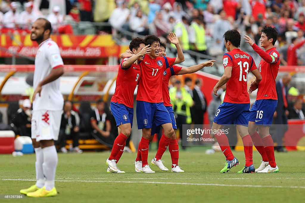 Korea Republic players celebrate after a goal by Cho Young Cheol during the 20145 Asian Cup match between Korea Republic and Oman at Canberra Stadium on January 10, 2015 in Canberra, Australia.
