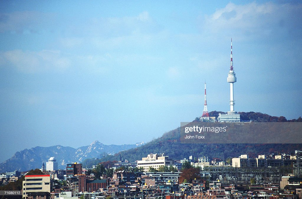 Korea, Seoul, View of cityscape with Namsan Tower in background : Stock Photo