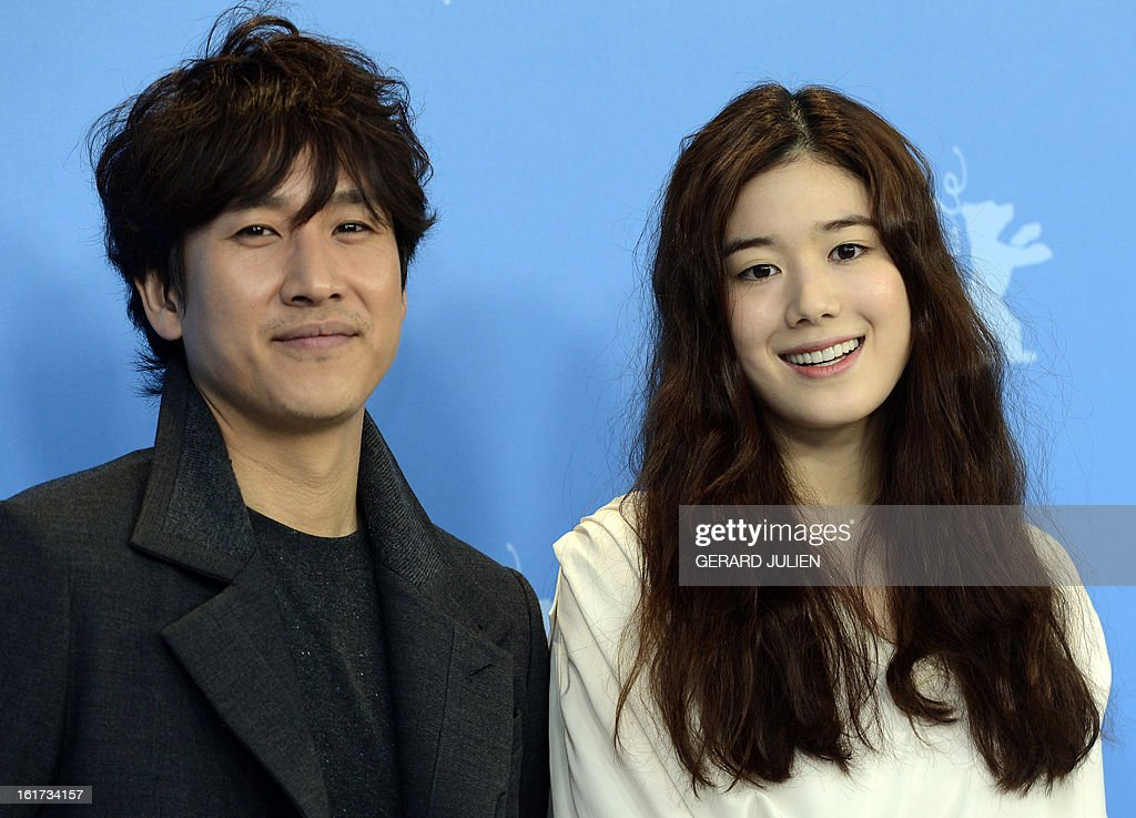 Korean actor Lee Sunkyun (L) and Korean actress Jung Eunchae (R) pose during a photocall for the film 'Nugu-Ui Ttal-Do Anin Haewon' (Nobody's Daughter Haewon) presented in the Berlinale Competition of the 63rd Berlin International Film Festival in Berlin on February 15, 2013.