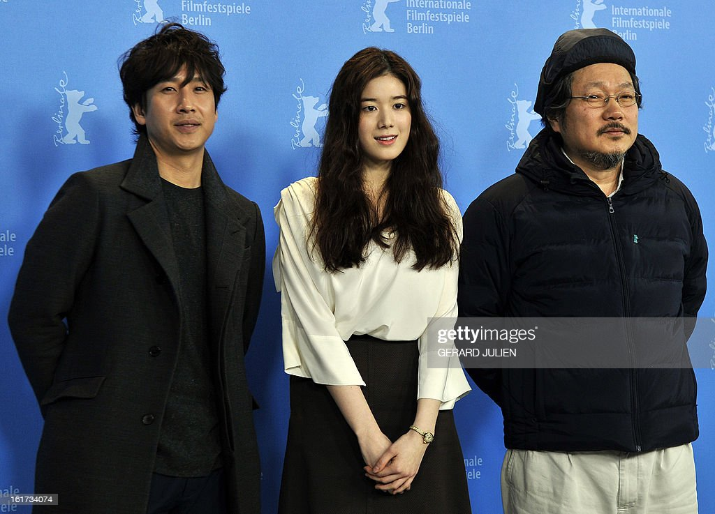 Korean actor Lee Sunkyun ,Korean actress Jung Eunchae and Korean director Hong Sangsoo pose during a photocall for the film 'Nugu-Ui Ttal-Do Anin Haewon' (Nobody's Daughter Haewon) presented in the Berlinale Competition of the 63rd Berlin International Film Festival in Berlin on February 15, 2013.