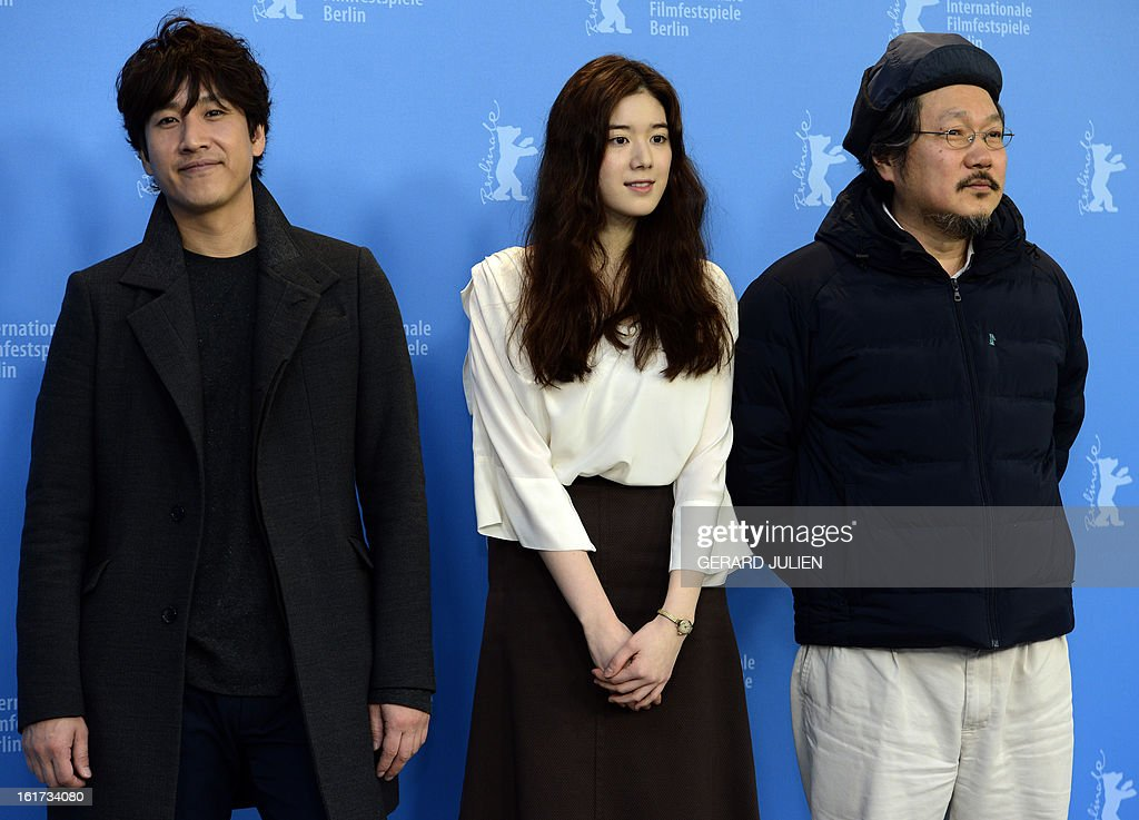Korean actor Lee Sunkyun, Korean actress Jung Eunchae and Korean director Hong Sangsoo pose during a photocall for the film 'Nugu-Ui Ttal-Do Anin Haewon' (Nobody's Daughter Haewon) presented in the Berlinale Competition of the 63rd Berlin International Film Festival in Berlin on February 15, 2013.