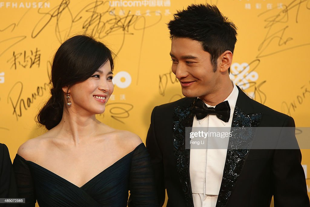 Korean actress Song Hye Kyo (Left) and Chinese actor <a gi-track='captionPersonalityLinkClicked' href=/galleries/search?phrase=Huang+Xiaoming&family=editorial&specificpeople=2136627 ng-click='$event.stopPropagation()'>Huang Xiaoming</a> (Right) arrive for the red carpet of 4th Beijing International Film Festival at China's National Grand Theater on April 16, 2014 in Beijing, China.