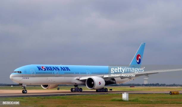 Korean Air Boeing 777 passenger jet taxis at the Dallas/Fort Worth International Airport located roughly halfway between Dallas and Fort Worth Texas