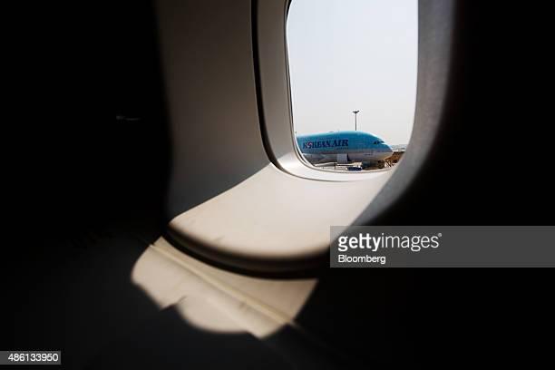 A Korean Air Lines Co Airbus A380800 aircraft on the tarmac is seen through the window of a Korean Air Lines Co Boeing Co 7478 passenger aircraft...
