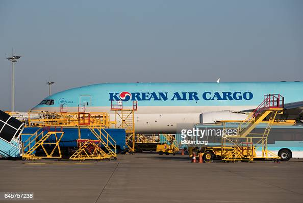 A Korean Air Lines Co cargo plane stands on the tarmac at Incheon International Airport in Incheon South Korea on Monday Feb 27 2017 Korean Air is in...