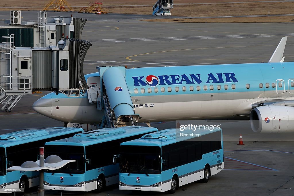 A Korean Air Lines Co. passenger aircraft stands on the tarmac at Incheon International Airport in Incheon, South Korea, on Monday, Jan. 27, 2014. Korean Air, the nation's biggest carrier, is scheduled to report full-year results on Feb. 3. Photographer: SeongJoon Cho/Bloomberg via Getty Images
