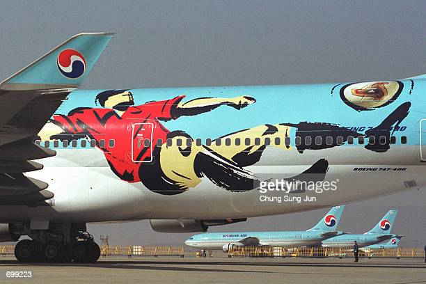 Korean Air unveils a fleet of aircraft that have logos of the 2002 Federation Internationale de Football Association World Cup February 7 2002 in...