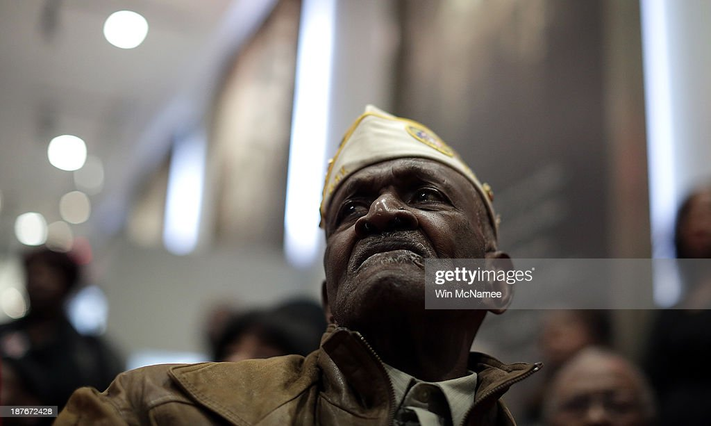 Korean and Vietnam War veteran James Patterson, age 81, attends a ceremony commemorating Veterans Day and honoring the Tuskegee Airmen November 11, 2013 in Washington, DC. The ceremony was held at the African American Civil War Museum on the day that World War I ended 95 years ago, the date the United States honors all of its military veterans.