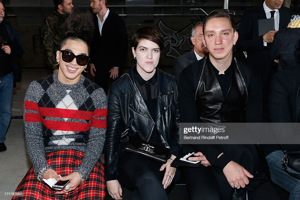 Korean artist <a gi-track='captionPersonalityLinkClicked' href=/galleries/search?phrase=Taeyang&family=editorial&specificpeople=7420405 ng-click='$event.stopPropagation()'>Taeyang</a> with the xx band's founders and singers <a gi-track='captionPersonalityLinkClicked' href=/galleries/search?phrase=Romy+Madley+Croft&family=editorial&specificpeople=6078322 ng-click='$event.stopPropagation()'>Romy Madley Croft</a> and <a gi-track='captionPersonalityLinkClicked' href=/galleries/search?phrase=Oliver+Sim&family=editorial&specificpeople=6078321 ng-click='$event.stopPropagation()'>Oliver Sim</a> attend Givenchy Menswear Spring/Summer 2014 Show as part of the Paris Fashion Week, held at City of Fashion and Design on June 28, 2013 in Paris, France.