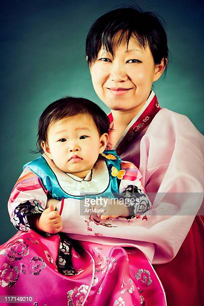 Korean baby girl and her mother in traditional hanbok