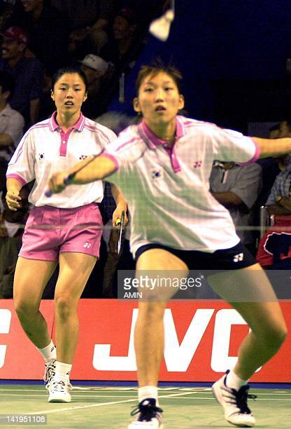 Korean badmiton players Yim Kyung Jin looks at her partner Lee Hyo Jung returns the shuttlecock in semifinal of JVC Asian Badminton Championship at...