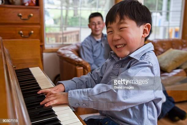 Korean boy playing piano
